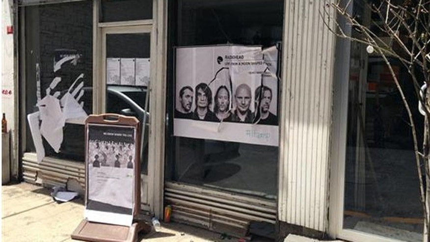 A ripped up poster advertising the streaming event of Radiohead's new album, at a record shop, in Istanbul, Saturday, June 18, 2016. (AP Photo/Dominique Soguel)