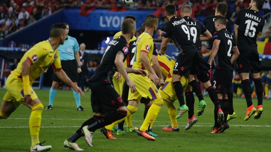 Albanian players deflect a free kick during the Euro 2016 Group A soccer match between Romania and Albania at the Grand Stade in Decines-Charpieu, near Lyon, France, Sunday, June 19, 2016. (AP Photo/Pavel Golovkin)