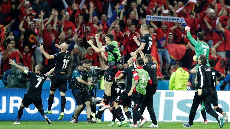 Albanian players celebrate their victory after Euro 2016 Group A soccer match between Romania and Albania at the Grand Stade in Decines-­Charpieu, near Lyon, France, Sunday, June 19, 2016. Albania won 1-0. (AP Photo/Pavel Golovkin)