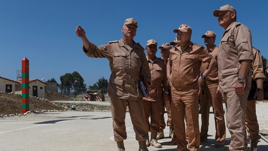 Russian Defense Minister Sergei Shoigu, second right, visits the Hemeimeem air base in Syria, Saturday, June 18, 2016. Russia's defense minister visited Syria on Saturday to meet the country's leader and inspect the Russian air base there, a high-profile trip intended to underline Moscow's role in the region. (Vadim Savitsky/Russian Defense Ministry Press Service pool photo via AP)