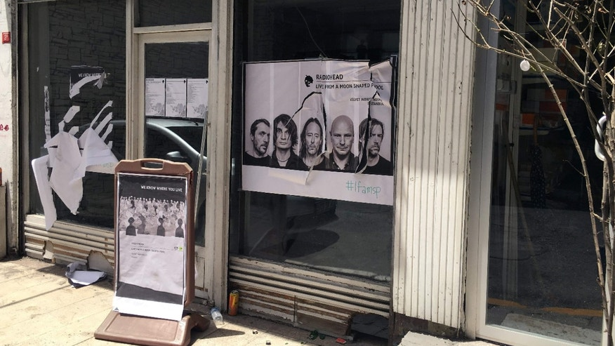 June 18, 2016: A ripped up poster advertising the streaming event of Radiohead's new album, at a record shop, in Istanbul.
