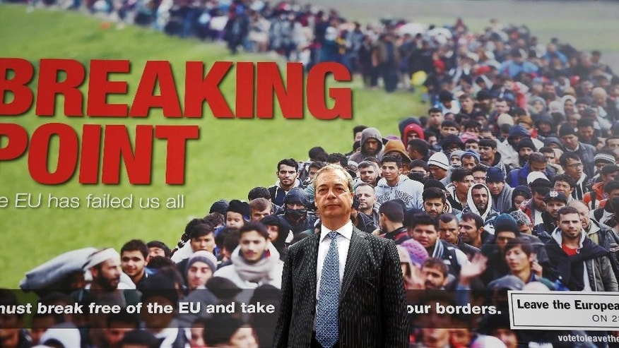"""FILE - In this June 16, 2016 file photo, Leader of the UK Independence Party Nigel Farage poses for the media in front of an EU referendum campaign poster in London. British Prime Minister David Cameron warned Sunday June 19, 2016 of the dangers of embracing """"leave"""" campaigner Nigel Farage's vision of Britain ahead of the country's referendum on its European Union membership. (Philip Toscano/PA via AP) UNITED KINGDOM OUT"""