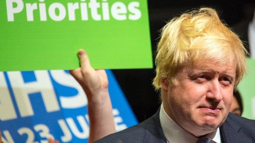 Former London Mayor Boris Johnson prepares to speak at a Vote Leave campaign event, at Old Billingsgate market, London, Sunday June 19, 2016. British voters head to the polls on Thursday to decide if the country should stay in the European Union or leave it. (Dominic Lipinski/PA via AP) UNITED KINGDOM OUT