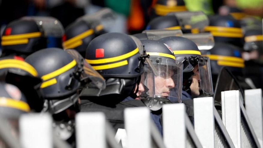 French riot police officers take their positions prior to the Euro 2016 Group F soccer match between Iceland and Hungary at the Velodrome stadium in Marseille, France, Saturday, June 18, 2016. Hungarian fans have clashed with stewards ahead of their team's game against Iceland at the European Championship. (AP Photo/Ariel Schalit)