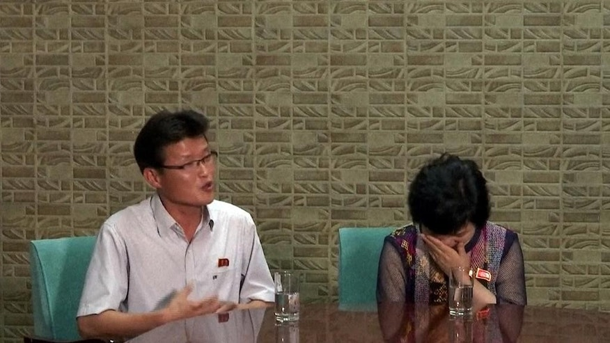 In this June 18, 2016 image taken from Associated Press Television News video, So Thae Song, left and Ri Gum Suk, right, speak to an Associated Press Television News crew during an interview.  The couple are the parents of So Kyong Ah, one of the waitresses now in South Korea. The first hearing in a landmark case involving 12 North Korean waitresses working in China who turned up in South Korea early this April is scheduled for Tuesday, June 21, 2016 in Seoul. (AP Photo/APTN)