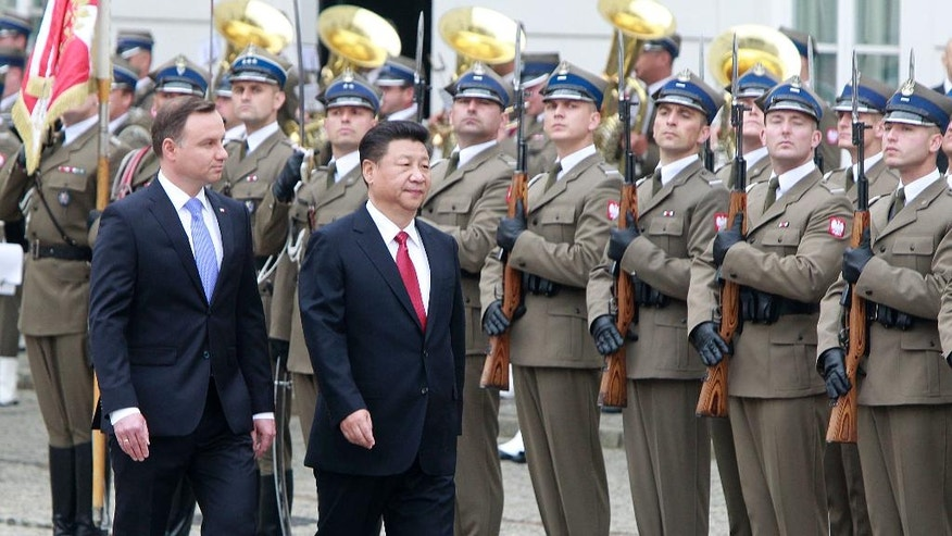 Chinese President Xi Jinping, right, and his Polish counterpart Andrzej Duda walk in front of the Guard of Honor during the welcoming ceremony in Warsaw, Poland, Monday, June 20, 2016. Xi Jinping came to Poland for an official visit. (AP Photo/Czarek Sokolowski)