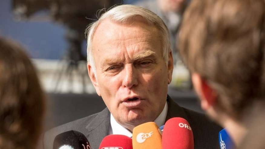 French Foreign Minister Jean-Marc Ayrault speaks with the media as he arrives for a meeting of EU foreign ministers at the EU Council building in Luxembourg, on Monday, June 20, 2016. EU foreign ministers meet Monday to discuss, among other issues, the situation in Libya. (AP Photo/Charles Caratini)