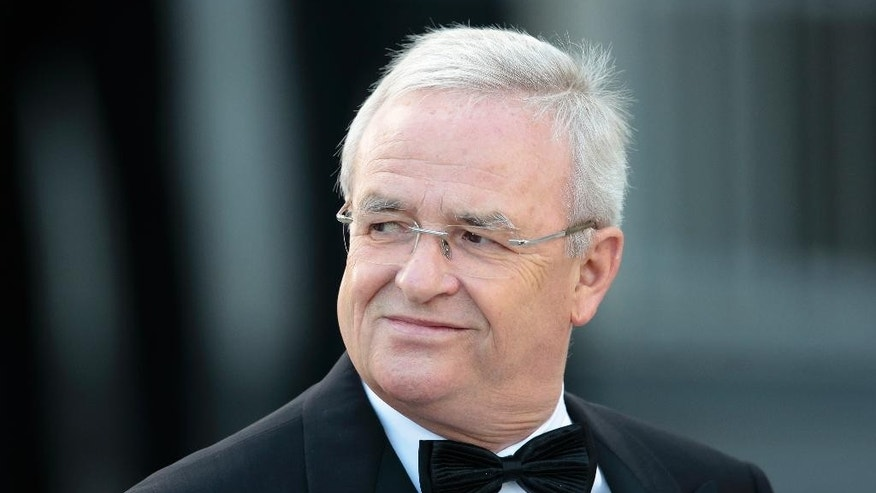 FILE - In this June 24, 2015 file picture then Volkswagen CEO Martin Winterkorn arrives for a state dinner at Germany's  President Joachim Gauck's residence, Bellevue Palace, in Berlin. German prosecutors said Monday June 20, 2016  they have opened an investigation of former Volkswagen CEO Martin Winterkorn on allegations of market manipulation in connection with the company's scandal over cars rigged to cheat on U.S. diesel emissions tests.  (AP Photo/Markus Schreiber.File)
