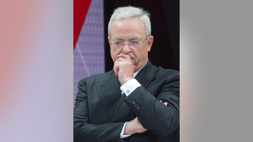 FILE - In this Sept. 17, 2015  file picture then  Volkswagen CEO Martin Winterkorn waits prior a presentation at the IAA Frankfurt Auto Show in Frankfurt, Germany.  German prosecutors said Monday June 20, 2016  they have opened an investigation of former Volkswagen CEO Martin Winterkorn on allegations of market manipulation in connection with the company's scandal over cars rigged to cheat on U.S. diesel emissions tests.    (AP Photo/Jens Meyer)
