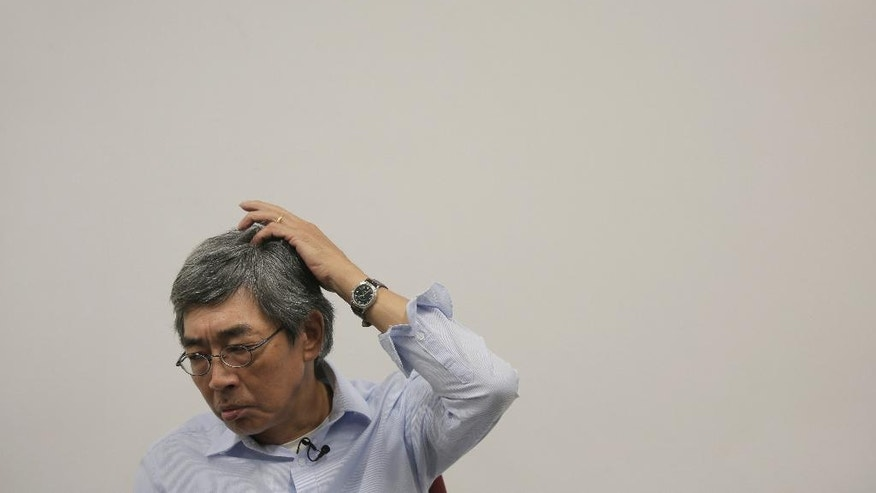 Hong Kong bookseller Lam Wing-kee reacts during an interview in Hong Kong, Sunday, June 19, 2016. The Hong Kong bookseller whose disappearance sparked international concern says he was so despondent during his detention by authorities in mainland China that he considered suicide. In an interview Sunday, Lam told The Associated Press that he thought about using his clothes to hang himself but couldn't find a way to do it in the small room where he was kept under constant watch for five months. (AP Photo/Vincent Yu)