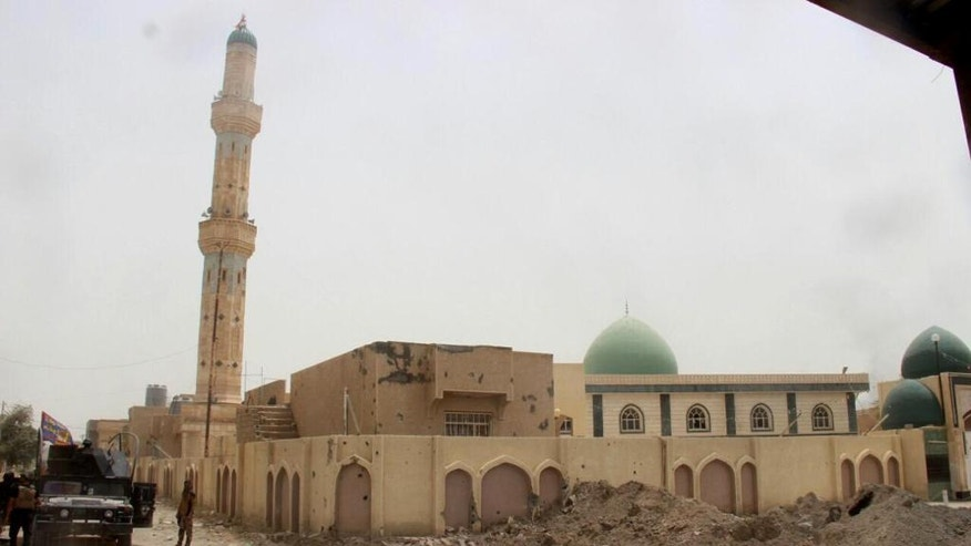 In this image taken by an Iraqi Counterterrorism Service photographer on Sunday, June 19, 2016 shows a mosque in Fallujah, Iraq after Iraqi troops regained control of the city after two years of Islamic State militant control. Thousands of civilians are fleeing Fallujah after the city was declared liberated from the Islamic State group, the United Nations said, while an Iraqi commander reported fierce clashes as elite counterterrorism forces pushed to clear out the remaining militants.(Iraq Counterterrorism Service via AP)