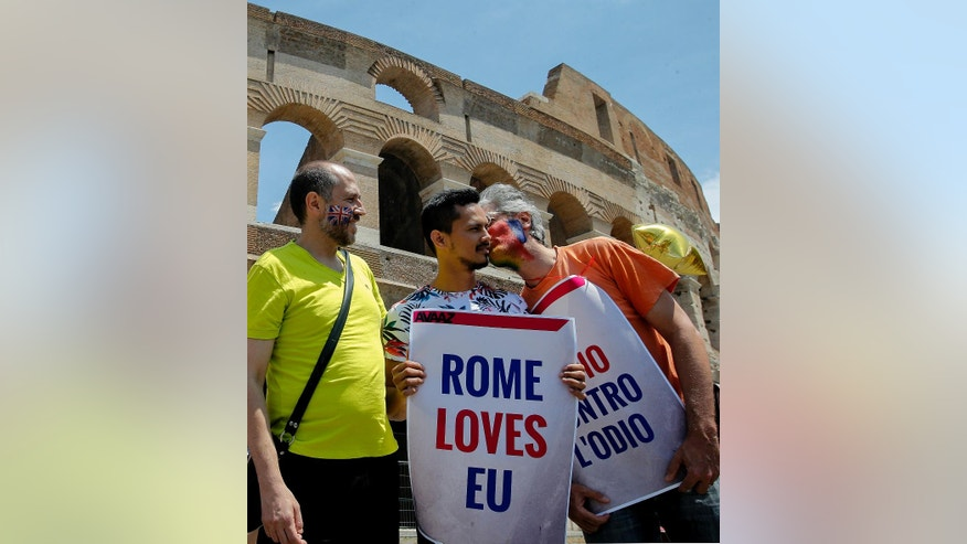 "Campaigners kiss and hug during a gathering, in front of Rome's ancient Colosseum, Sunday, June 19, 2016. With the ""Anglo-European kiss-in""  Britons and Europeans attempted to show love between Britain and Europe by kissing.  British voters head to the polls on Thursday to decide if the country should stay in the European Union or leave it. (AP Photo/Fabio Frustaci)"
