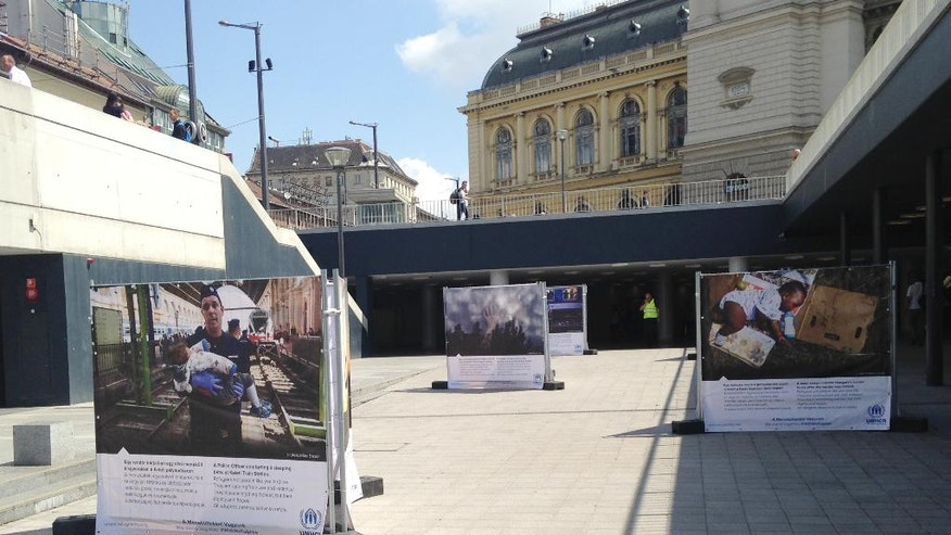 Photos of refugees are set up at the opening of a photo exhibit by the U.N. refugee agency UNHCR at the Keleti railway terminal in Budapest, Hungary, Monday, June 20, 2016. Last year thousands of migrants a day were passing through the railway station. on their way to Germany and other western destinations before Hungary built fences on its borders with Serbia and Croatia. (AP Photo/Pablo Gorondi)