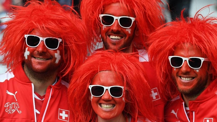 Switzerland supporters pose on the stands before the Euro 2016 Group A soccer match between Switzerland and France at the Pierre Mauroy stadium in Villeneuve d'Ascq, near Lille, France, Sunday, June 19, 2016. (AP Photo/Geert Vanden Wijngaert)