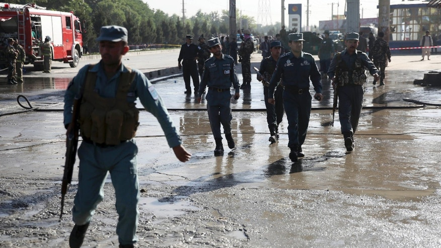 June 20, 2016: Afghan police soldiers inspect the site of a suicide attack in Kabul, Afghanistan.