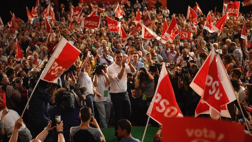In this Sunday, June 19, 2016 photo, Pedro Sanchez, leader of the Spanish Socialist Party, center, applauds his followers during a campaign election rally in Zaragoza, northern Spain. After heading six governments and dominating the left for nearly four decades, Spain's Socialist party faces an unprecedented risk of being overtaken by an upstart far left alliance during the country's June 26 repeat election. It's a development that would upend the nation's political landscape for the second time in just six months.(AP Photo/Alvaro Barrientos)