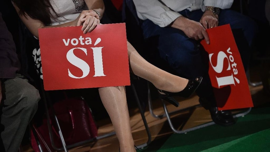 In this Friday, June 17, 2016 photo, followers of Pedro Sanchez, leader of Spanish Socialist Party, hold banners reading, ''Vote Yes'', during an electoral meeting in Logrono, northern Spain. After heading six governments and dominating the left for nearly four decades, Spain's Socialist party faces an unprecedented risk of being overtaken by an upstart far left alliance during the country's June 26 repeat election. It's a development that would upend the nation's political landscape for the second time in just six months. (AP Photo/Alvaro Barrientos)