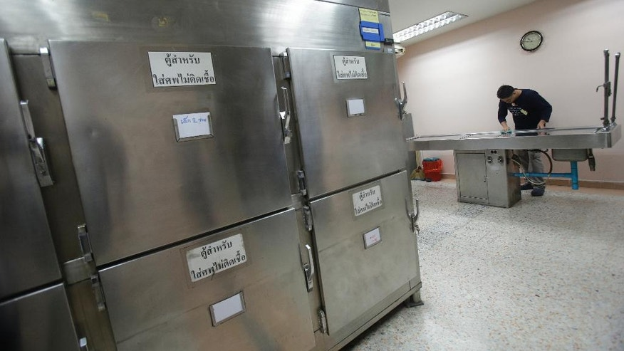 A Thai man convicted of drunk drinking cleans an autopsy table at Taksin Hospital in Bangkok, Thailand, Monday, June 20, 2016.  A group of convicted drunken drivers were brought to a Bangkok morgue Monday to see a corpse and reflect on the gory consequences of their actions as part of a program aimed at combating the carnage on Thailand's roads. Thailand has the second-worst record in the world for traffic fatalities, according to the World Health Organization, just behind Libya. Most of the road accidents are caused by drunken driving. (AP Photo/Sakchai Lalit)