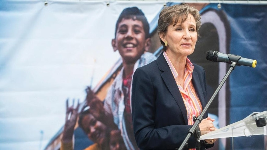 "UNHCR's Regional Representative for Central Europe Montserrat Feixas Vihe delivers her speech during the opening of the photo exhibition entitled 'From War To Hope', organized by the Central European Office of UNHCR at the Keleti railway terminal in Budapest, Hungary, Monday, June 20, 2016. Feixas Vihe said it was ""major problem"" that while conditions in the countries refugees are fleeing from had not improved, it was now much harder for them to seek protection in Europe.(Janos Marjai/MTI via AP)"