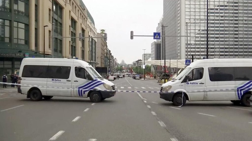 This image taken from video shows the scene near the City 2 shopping center following a pre-dawn security alert in downtown Brussels, Tuesday, June 21, 2016. Brussels prosecutors confirmed that a man had been taken into custody early Tuesday, but that no explosives were found. (AP Photo)