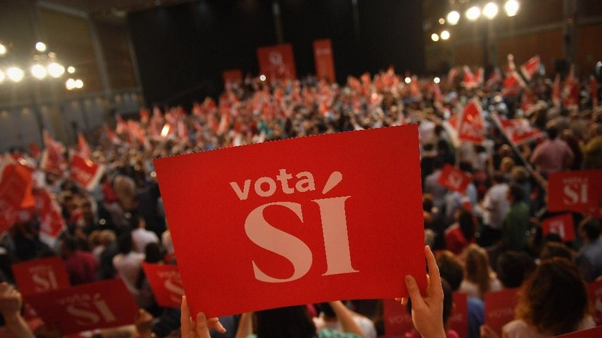 In this Sunday, June 19, 2016 photo, followers of Pedro Sanchez, leader of the Spanish Socialist Party, wave banners calling for the ''Vote Yes'' during a campaign election rally in Zaragoza, northern Spain. Just six months after casting ballots for a new government, Spaniards are heading back to the polls in an unprecedented repeat election. (AP Photo/Alvaro Barrientos)