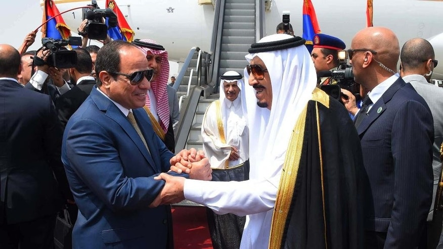 FILE - In this Monday, April 11, 2016 file photo provided by the office of the Egyptian Presidency, Egyptian President Abdel-Fattah el-Sissi, left, shakes hands with Saudi Arabia's King Salman before he departs Egypt. An Egyptian court has rejected as illegal a demarcation border agreement between Egypt and Saudi Arabia under which Cairo would surrender control over two Red Sea islands to Riyadh. (Sherif Abdel Minoem, Egyptian Presidency via AP, File)