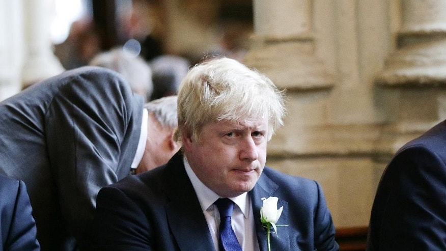 Former London Mayor Boris Johnson attends a service of prayer and remembrance in St Margaret's Church, London, Monday, June 20, 2016, to commemorate Jo Cox, the 41-year-old Member of Parliament fatally shot last week in northern England. The mother of two was shot Thursday afternoon in her constituency near Leeds. The man charged with her slaying made a brief appearance in court by video link from prison Monday. (Yui Mok/Pool via AP)