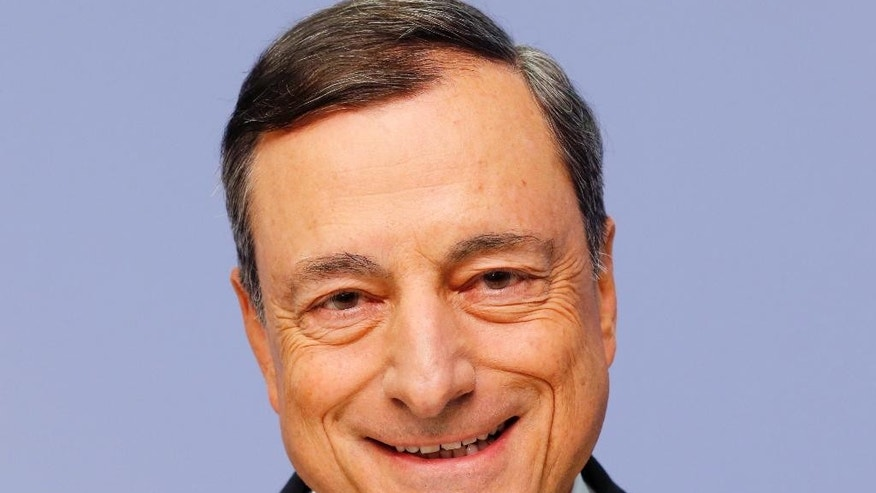FILE - In this Sept. 3, 2015 file picture President of European Central Bank, ECB,  Mario Draghi smiles prior to a news conference in Frankfurt, Germany, following a meeting of the ECB governing council. Germany's constitutional court has rejected a challenge to a European Central Bank bond-buying program credited with helping keep the euro currency union from breaking up in 2012. The court in Karlsruhe said Tuesday June 21, 2016 that the ECB had not exceeded its legal powers and rejected arguments from legislators and a citizens' group that the offer to purchase government bonds of troubled countries violated German law. (AP Photo/Michael Probst,file)