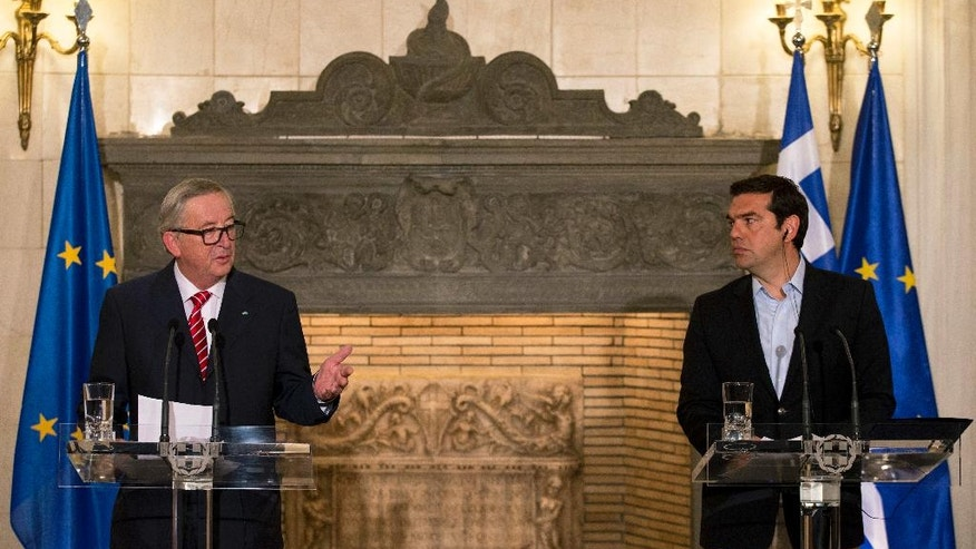 European Commission President Jean-Claude Juncker, left, speaks next to Greek Prime Minister Alexis Tsipras during a joint news conference and after their meeting in Athens, on Tuesday, June 21, 2016. (AP Photo/Petros Giannakouris)