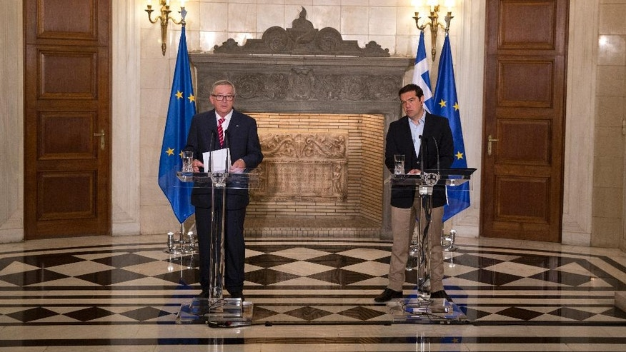 European Commission President Jean-Claude Juncker, left, speaks next to Greek Prime Minister Alexis Tsipras during a join news conference and after their meeting in Athens, on Tuesday, June 21, 2016. (AP Photo/Petros Giannakouris)