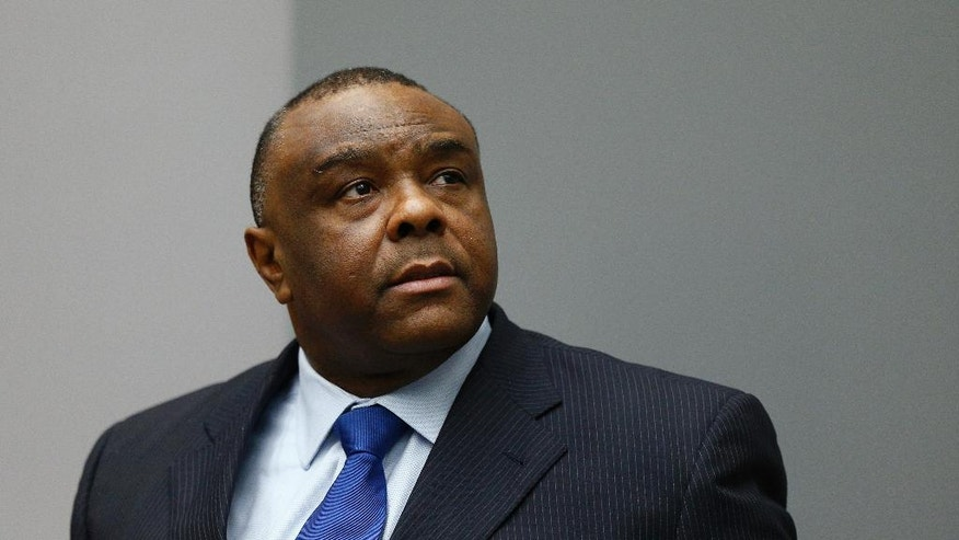 Jean-Pierre Bemba enters the court room of the International Criminal Court in The Hague, Netherlands, Tuesday, June 21, 2016. The ICC delivered its sentence against former Congolese vice president Bemba who was found guilty, on 21 March 2016, of two counts of crimes against humanity (murder and rape) and three counts of war crimes (murder, rape, and pillaging) in the Central African Republic more than a decade ago.  (AP Photo/Michael Kooren, Pool)