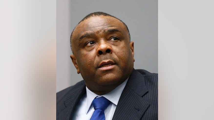Jean-Pierre Bemba takes his seat in the court room of the International Criminal Court in The Hague, Netherlands, Tuesday, June 21, 2016. The ICC delivered its sentence against former Congolese vice president Bemba who was found guilty, on 21 March 2016, of two counts of crimes against humanity (murder and rape) and three counts of war crimes (murder, rape, and pillaging) in the Central African Republic more than a decade ago.  (AP Photo/Michael Kooren, Pool)