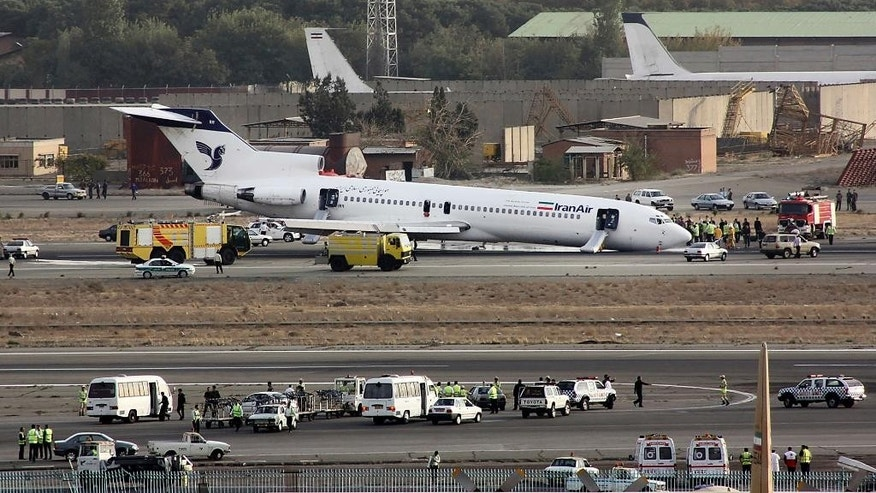 "FILE- In this Tuesday, Oct. 18, 2011 FILE photo, an Iran Air Boeing 727 landed on its nose, after the landing gear jammed, at the Mehrabad airport in Tehran, Iran. Boeing Co. has confirmed signing an agreement with Iran Air ""expressing the airline's intent"" to buy its aircraft. In a statement Tuesday to The Associated Press, Boeing said it signed the agreement ""under authorizations from the U.S. government following a determination that Iran had met its obligations under the nuclear accord reached last summer."" (AP Photo/Hamid Reza Jafari, File)"