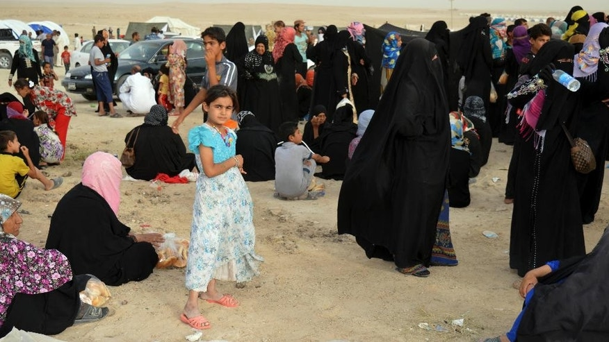 Internally displaced civilians from Fallujah, who fled their homes during fighting between Iraqi security forces and Islamic State group, arrive to a camp outside Fallujah, Iraq, Monday, June 20, 2016.  The U.N. refugee agency says just over 65 million people were displaced worldwide by the end of last year, easily setting a new postwar record, as it warned that European and other rich nations can expect the tide to continue if root causes aren't addressed. (AP Photo)