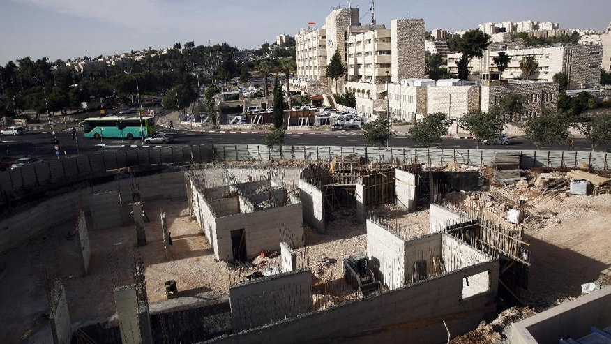This May 17, 2016 photo shows construction on land owned by Palestinian Mohammad Abu Ta'a, in east Jerusalem. Abu Ta'a discovered some years ago that the Israeli government had expropriated the piece of land in Jerusalem belonging to his family and handed it over to a leading organization that oversees Jewish settlement building in the West Bank. Now, the Palestinian landowner is fighting back in an unusual way -- enlisting Israeli lawyer Stephen Berman whose inside knowledge of the system is helping Abu Ta'a expose the settler organization's property grab. (AP Photo/Mahmoud Illean)