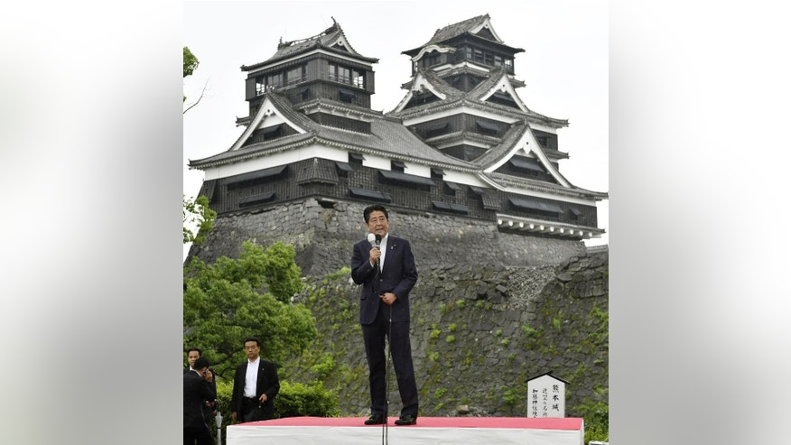 Japanese Prime Minister Shinzo Abe delivers a speech during an election campaign for his ruling Liberal Demoicratic Party in front of the earthquake damaged Kumamoto Castle in Kumamoto, southern Japan, Wednesday, June 22, 2016. Japan's parliamentary election campaign kicked off Wednesday in the first nationwide balloting after the voting age was lowered to 18 from 20. (Nobuki Ito/Kyodo News via AP) JAPAN OUT, CREDIT MANDATORY