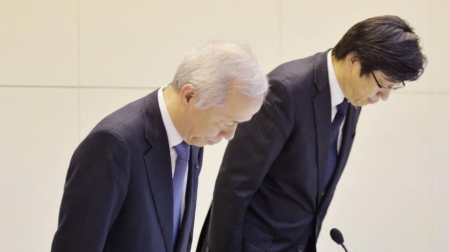 "Tokyo Electric Power Co. President Naomi Hirose, left,  and senior director Takafumi Anegawa bow during a press conference at the TEPCO headquarters in Tokyo, Tuesday, June 21, 2016.  The utility that ran the Fukushima nuclear plant acknowledged Tuesday its delayed disclosure of the meltdowns at three reactors was tantamount to a cover-up and apologized for it.  Tokyo Electric Power Co. President Hirose's apology followed the revelation last week that an investigation had found Hirose's predecessor instructed officials during the 2011 disaster to avoid using the word ""meltdown."" (Kyodo News via AP) JAPAN OUT, MANDATORY CREDIT"