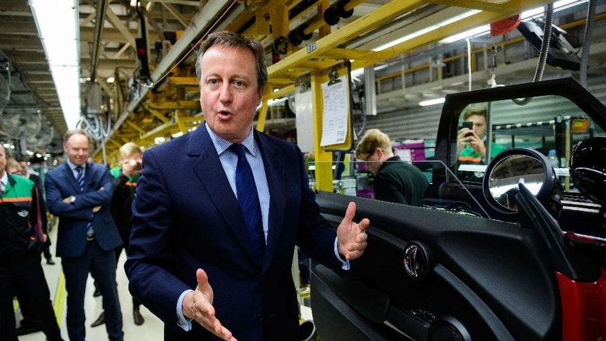 "Britain's Prime Minister David Cameron speaks during his tour of the BMW Mini plant in Oxford England, while on  a ""Remain"" EU referendum campaign visit Monday June 20, 2016. Britain goes to the polls in a referendum on Thursday on whether to leave or remain in the EU. (Leon Neal/PA via AP) UNITED KINGDOM OUT"