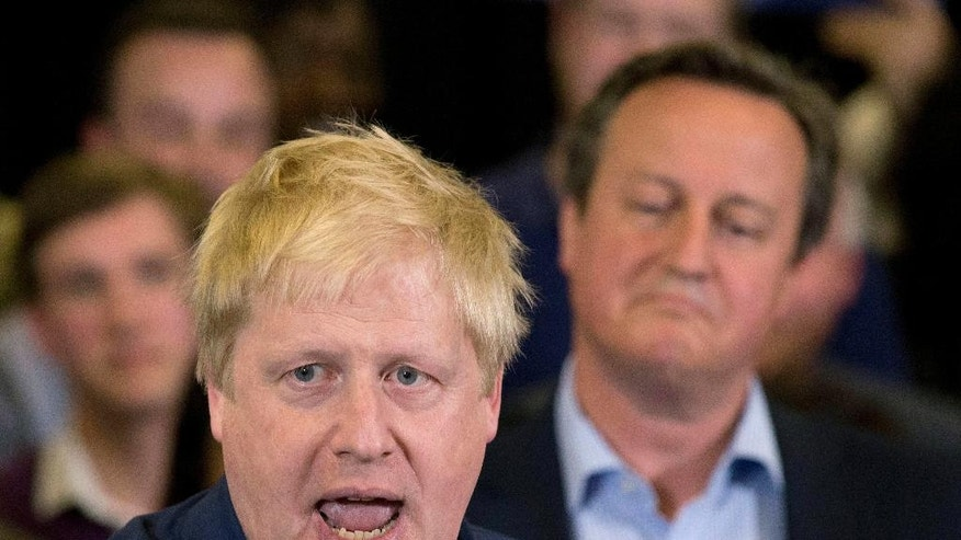 "FILE - This is a  Tuesday, May 3, 2016  file photo of Britain's Prime Minister David Cameron, right, as he listens as the then Mayor of London Boris Johnson speaks at a mayoral election campaign rally for  Conservative party candidate for Mayor of London Zac Goldsmith  in  London.  Johnson has made his move. He should find out Friday morning June 24, 2016 if it pays off. The safe course for the ambitious former London mayor would have been to back his longtime political ally David Cameron's bid to keep Britain inside the European Union in Thursday's referendum and let the prime minister sink or swim.  Instead, Johnson decided in February to lead the ""leave"" campaign and use his considerable clout to try to pry Britain out of the EU .  (AP Photo/Matt Dunham, File)"