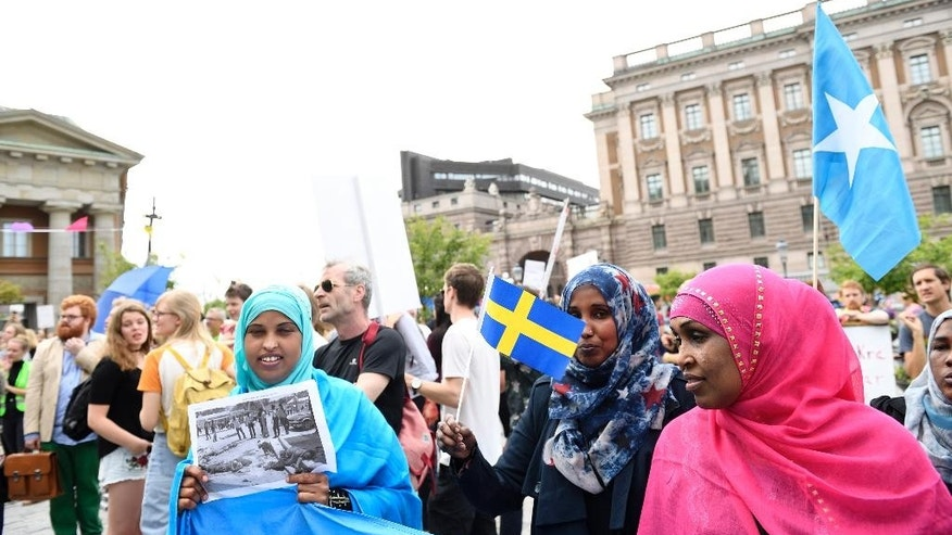 Protesters  gather in front of Sweden's parliament in Stockholm Tuesday June 21, 2016. Swedish lawmakers overwhelmingly approved legislation to tighten regulations for asylum and family reunification in the Scandinavian country which had a record 160,000 asylum-seekers last year. (Henrik Montgomery/ TT via AP) SWEDEN OUT