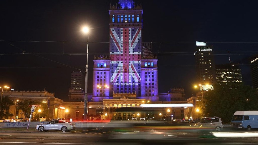 The Palace of Culture and Science is illuminated with British flag by Warsaw's capital authorities in support of Britain staying in the EU, in Warsaw, Poland, Wednesday, June 22, 2016. On Thursday Britain votes in a national referendum on whether to stay inside the EU, a momentous decision with far-reaching implications for Britain and Europe.(AP Photo/Czarek Sokolowski)