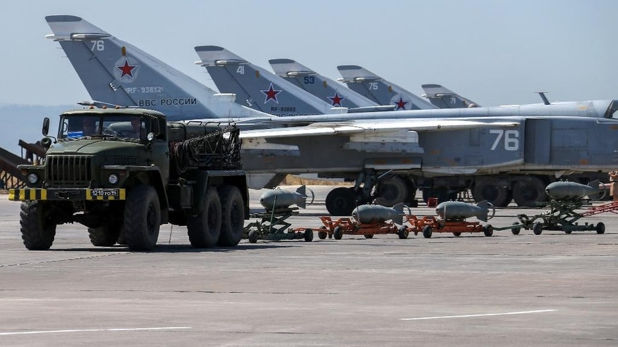 FILE - In this Saturday, June 18, 2016 file photo, Russian fighter jets and bombers are parked at Hemeimeem air base in Syria. The Syrian government has suffered serious setbacks in its campaign to retake the Islamic State's de facto capital of Raqqa, even with Russia's support. (Vadim Savitsky/Russian Defense Ministry Press Service pool photo via AP, File)