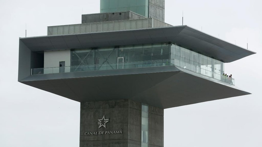 Workers stand on the balcony of the control tower on the newly expanded Panama Canal on Pacific side, in Cocoli, Panama, Monday, June 20, 2016. The canal's expansion project will be officially inaugurated on June 26. (AP Photo/Arnulfo Franco)