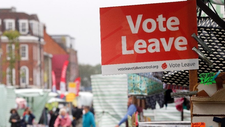 A Vote Leave sign is fixed on a market stall at Havering's Romford street market in London, Wednesday, June 1, 2016. When Britain decides on Thursday June 23, 20916, whether to leave the European Union, London's voice may prove decisive. But for which side? Britain's capital, home to almost 9 million people, encompasses the most pro-EU place of the country, and the least. In the cosmopolitan City financial district, where almost half a million people from around the globe work in Europe's biggest financial center, pro-EU sentiment predominates. But just a few miles away, the borough of Havering, stronghold of working-class East Enders, topped a national survey of the most anti-EU places in Britain.(AP Photo/Frank Augstein)