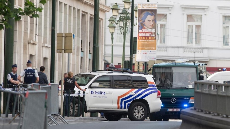 Vans and a police escort arrive for a court hearing for suspect Mohamed Abrini at the Court of Appeals in Brussels on Thursday, June 23, 2016. A Brussels appeals court panel met Thursday to consider France's extradition request for Mohamed Abrini, 31, a suspect in the Paris and Brussels attacks that were claimed by the Islamic State organization. (AP Photo/Virginia Mayo)