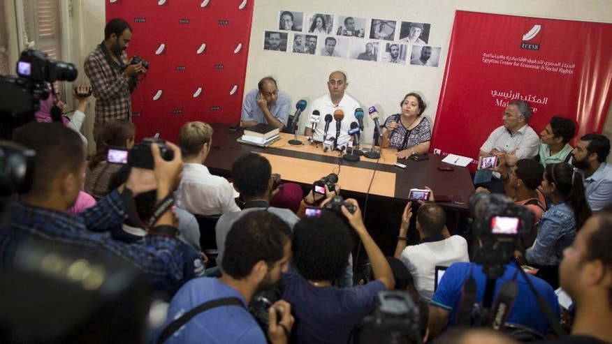 Egyptian lawyer and former presidential candidate Khaled Ali, center, speaks during a press conference on two disputed Red Sea islands, at the Egyptian Center for Economic and Social Rights, in Cairo, Egypt, Wednesday, June 22, 2016. An Egyptian court has rejected as illegal a demarcation border agreement between Egypt and Saudi Arabia under which Cairo would surrender control over two Red Sea islands to Saudi Arabia. (AP Photo/Amr Nabil)