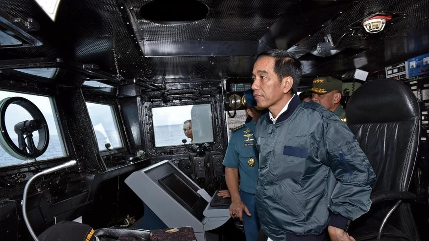 In this photo released by the Indonesian Presidential Office, Indonesian President Joko Widodo stands on the bridge of navy warship KRI Imam Bonjol, as it sails on the waters of Natuna Islands, Indonesia, Thursday, June 23, 2016. Widodo visited the Natuna islands Thursday in a move designed to send a message about the country's commitment to protecting its sovereignty in the area at the edge of the South China Sea. (AP Photo/Agus Suparto, Indonesian Presidential Office)