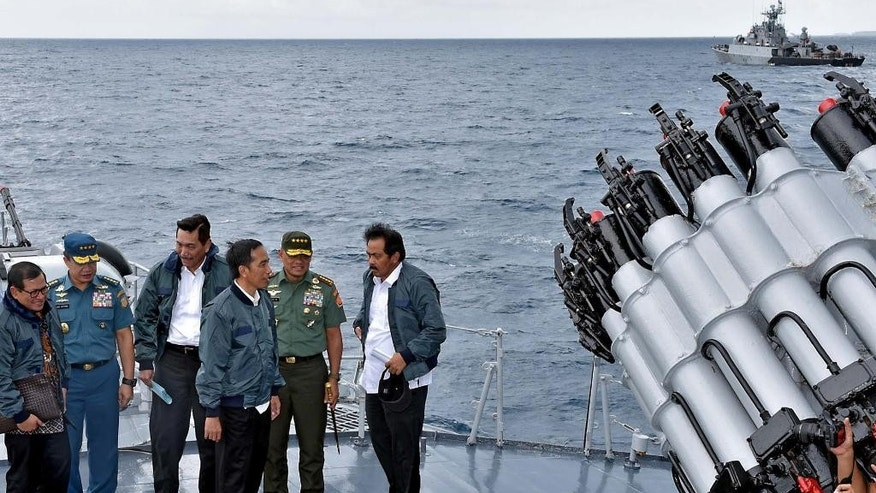 In this photo released by the Indonesian Presidential Office, Indonesian President Joko Widodo, third right, accompanied by, from left to right, Cabinet Secretary Pramono Anung, Navy Chief of Staff, Adm. Ade Supandi, top security minister Luhut Panjaitan, Armed Forces Chief Gen. Gatot Nurmantyo and Riau Islands Governor Nurdin Basirun stands on the deck of navy warship KRI Imam Bonjol, on the waters of Natuna Islands, Indonesia, Thursday, June 23, 2016. Widodo visited the Natuna islands Thursday in a move designed to send a message about the country's commitment to protecting its sovereignty in the area at the edge of the South China Sea. (AP Photo/Agus Suparto, Indonesian Presidential Office)