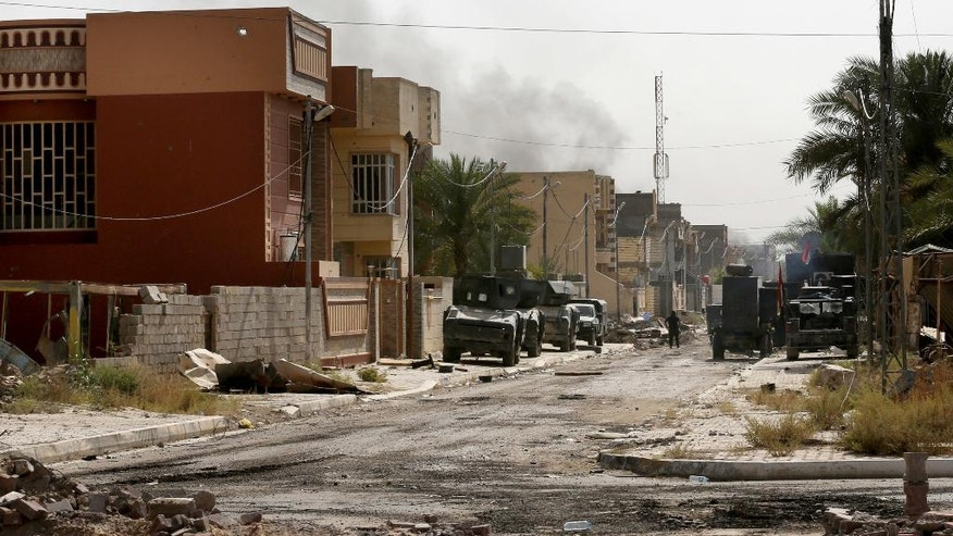 Iraqi counter-terrorism forces advance their positions in Fallujah, Iraq, Wednesday, June 22, 2016. Pockets of Islamic State fighters continue to hold neighborhoods along the north and west of the city. (AP Photo/Hadi Mizban)