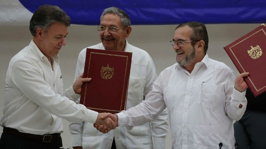 Colombian President Juan Manuel Santos, left, and FARC Commander  Timoleon Jimenez on June 23, 2016.